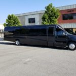 black luxury coach by sunset luxury limousines