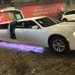 Sunset Luxury Limousine's white 2019 Chrysler 300C Gullwing Wedding Limo
